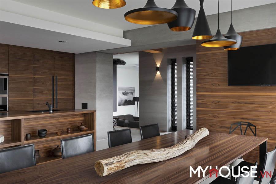 dùng thanh gỗ mộc ngăn bàn ăn là 1 ý tưởng độc đáo của căn hộ hiện đại này